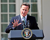 Prime Minister David Cameron of Great Britain answers a reporter's question during a joint press conference with United States President Barack Obama (not pictured) in the Rose Garden of the White House in Washington, D.C. on Wednesday, March 14, 2012.  The two leaders took questions on Afghanistan, Iran, and the economy..Credit: Ron Sachs / CNP