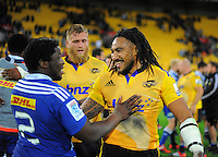 Ma'a Nonu jokes with Siyibonga Ntubeni after the Super Rugby match between the Hurricanes and Stormers at Westpac Stadium, Wellington, New Zealand on Friday, 2 April 2015. Photo: Dave Lintott / lintottphoto.co.nz