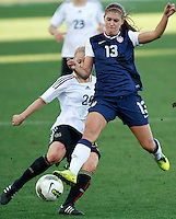USA's Alex Morgan fights for the ball with Germany's Leonie Maier during their Algarve Women's Cup soccer match at Algarve stadium in Faro, March 13, 2013.  .