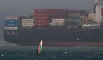 A windsurfer had the right way over a super tankers steaming into the San Francisco Bay.