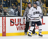 Chris Millea, Damon Kipp (UNH - 4) - Mike Sislo (UNH - 19) in the box. - The Merrimack College Warriors defeated the University of New Hampshire Wildcats 4-1 (EN) in their Hockey East Semi-Final on Friday, March 18, 2011, at TD Garden in Boston, Massachusetts.