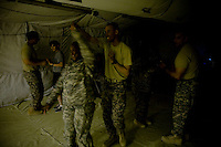 "US soldiers from Spartans Task Force during Salsa dancing lessons on ""Latin night"" at the MWR of FOB Shank in Logar province, Afghanistan on Sunday, May 31st 2009...Photo: Guilad Kahn."