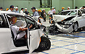 "July 21st, 2011, Susonosi, Japan - Toyota technicians check a badly damaged Crown, left, and a VITZ after a head-on collision at the speed of 55km/h (about 34 miles/h) in a demonstration at Toyotas Higashi-Fuji Technical Center on the foot of Mt. Fuji, some 92km (about 57 miles) southwest of Tokyo, on Thursday, July 21, 2011. Toyota showed to reporters technologies aimed at increasing safety for pedestrians and elderly drivers, as part of its initiatives to eliminate traffic casualties. The technologies include a Pre-Collision System with collision-avoidance assist, glare-preventing adaptive driving beams and a pop-up hood for lessening pedestrian injury. In the PCS, Toyota uses cameras and a super sensitive radar called ""millimeter-wave,"" both installed in the front of the vehicle, to detect possible crashes such as a pedestrian crossing the road. Then the vehicle calculates how braking and steering must be applied to avoid a crash. (Photo by Natsuki Sakai/AFLO) [3615] -mis-."