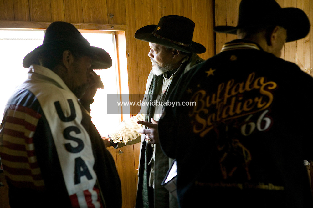 2 December 2006 - New York City, NY - Jessie Wise (L), Willie Dunn (C) and Warren Smalls, aka Black Red, members of the Federation of Black Cowboys, chat after lunch at the Cedar Lanes stables in the borough of Queens in New York City, USA, 2 December 2006. The Federation gathers black men and women who recreate the heritage of black cowboys, teach kids to ride and put on 'rodeo showdeos'.
