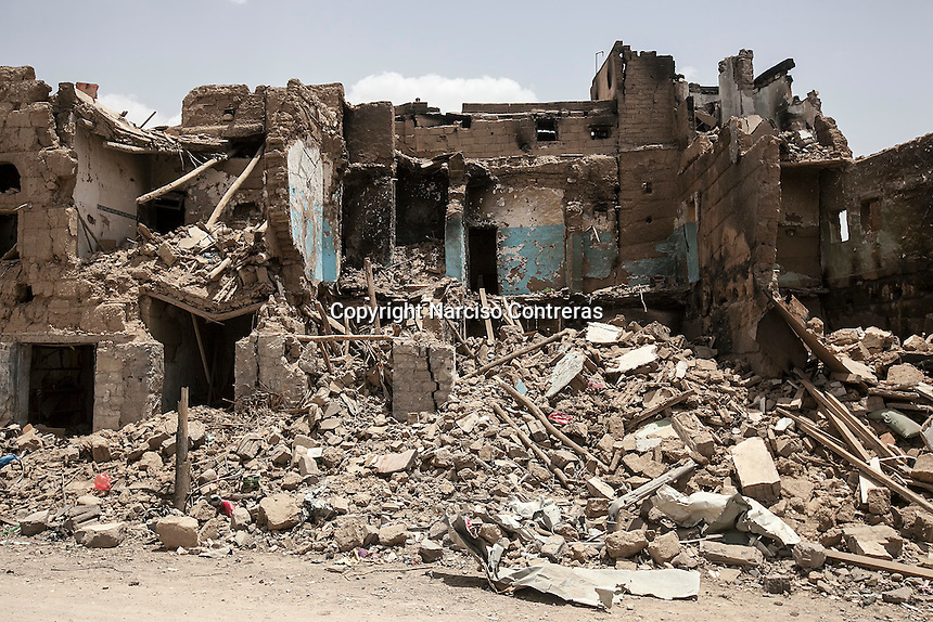 Wednesday 15 July, 2015: Blocks of apartment houses are seen downed to the ground in a market area in the downtown of Sa'dah, a city subdued to heavy bombarments carried out by the Saudi-led coalition air force in the northern province of Sa'dah, the stronghold of the Houthi's movement in Yemen. (Photo/Narciso Contreras)