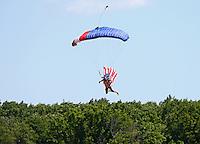 Jun 12, 2016; Englishtown, NJ, USA; A skydiver parachutes into the track with the American flag prior to the NHRA Summernationals at Old Bridge Township Raceway Park. Mandatory Credit: Mark J. Rebilas-USA TODAY Sports