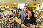 Paul Harrahan of Action Lesotho with a Library Book which was taken out in March 1931 pictured with librarian Martina Daly.