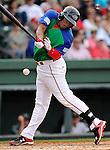 Left fielder Carlos Mesa (28) of the Greenville Drive bats in a game against the Augusta GreenJackets on Sunday, April 12, 2015, at Fluor Field at the West End in Greenville, South Carolina. Augusta won, 2-1. (Tom Priddy/Four Seam Images)