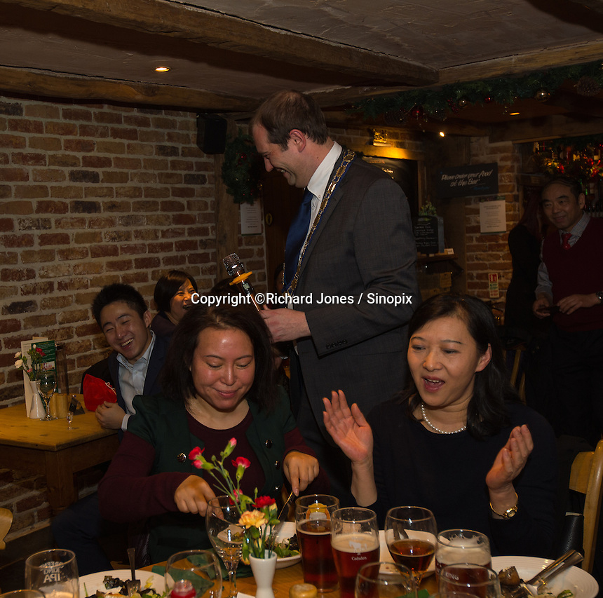 Matthew Walsh, Town Mayor &amp; Chairman, Princes Risborough Town Council, (Peter Zhang is next to him laughing) at a party with members of the Chinese-UK Business Alliance in The Plough at Cadsden, Buckinghamshire. SinoFortone Group bought the pub after it was visited by Chinese Premiere Ji Jinping last year, and aim to develop  a chain of English-style pubs China.<br /> <br /> Photo by Richard Jones