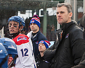Josh Holmstrom (UML - 12), Norm Bazin (UML - Head Coach) - The Northeastern University Huskies defeated the University of Massachusetts Lowell River Hawks 4-1 (EN) on Saturday, January 11, 2014, at Fenway Park in Boston, Massachusetts.
