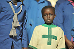 A girl in a children's choir as it sings during a worship service of Nuer refugees from South Sudan who live in Cairo, Egypt. The service took place at St Andrews United Church of Cairo.