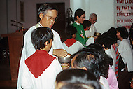 In Ho Chi Minh City, Saigon, February 1988. Scene on Sunday morning in the main Cathedral.