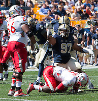 Pitt defensive lineman Aaron Donald (97) tackles New Mexico running back Crusoe Gongbay (2) and then points to New Mexico left guard Lamar Bratton (66). The Pitt Panthers defeated the New Mexico Lobos 49-27 on Saturday, September 14, 2013 at Heinz Field, Pittsburgh, Pennsylvania.