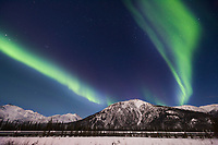Trans Alaska oil pipeline and aurora borealis, Brooks range, Alaska