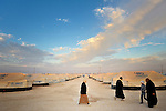 People walk in the Zaatari Refugee Camp, located near Mafraq, Jordan. Opened in July, 2012, the camp holds upwards of 50,000 refugees from the civil war inside Syria, but its numbers are growing. International Orthodox Christian Charities and other members of the ACT Alliance are active in the camp providing essential items and services.