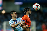 Brisbane Roar Thomas Broich (top) and Sydney FC Joel Chianese during their A-League match in Sydney, March 14, 2014. Photo by Daniel Munoz/VIEWPRESS EDITORIAL USE ONLY