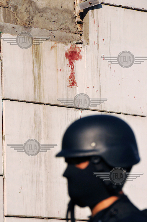 Blood on the wall of a murder scene in Culiacan...