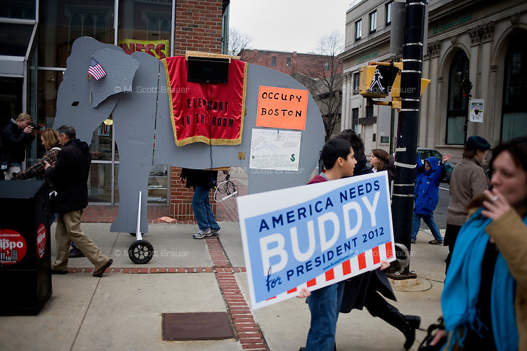 Protesters march in a Pride Parade in downtown Manchester, New Hampshire, on Jan. 7, 2012.  Some of the protesters are part of Occupy New Hampshire or Occupy the Primary.