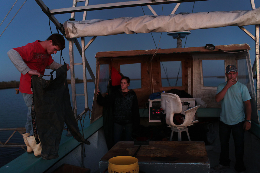 Jason Melerine shrimping at dusk with Katie Landry and Stephen Tircuit on Delacroix Island, LA on November 8, 2010.