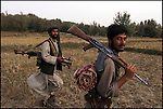 Mujahideen walk towards the frontline close to the Amu Darya river near the village of Dasht-e-Qala, Takhar Province.<br /> <br /> Afghanistan 9 October 2001