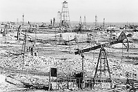 Azerbaijan. Baku Region. Baku. State Oil Company of Azerbaijan Republic (SOCAR) is the project owner of the oil fields in Bibi Heybat. Oil-extracting infrastructure. Wells heads and nodding donkeys. Drilling derricks and rigs. Oil production. Ecological disaster. Bibi-Heybat Oil Field (BHOF) is situated at the coast of the Caspian Sea and is a source of pollution as a result of well water and oil spill discharge into the Baku Bay. © 2007 Didier Ruef