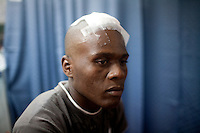 Lauture Desawe is treated for a head wound on board the USNS Comfort, a naval hospital ship, on Wednesday, January 20, 2010 in Port-Au-Prince, Haiti. The Comfort deployed from Baltimore, bringing nearly a thousand medical personnel to care for victims of Haiti's recent earthquake.