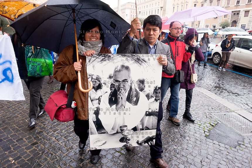Roma 22 Marzo 2015<br /> La Caritas di Roma  celebra  la &laquo;Settimana della carit&agrave;&raquo; che quest&rsquo;anno coincide con le celebrazioni per il 35&deg; anniversario del martirio del vescovo salvadoregno Oscar Romero che verr&agrave; beatificato il 23 maggio. Concelebrazione dell&rsquo;Eucaristia a Santa Maria in Traspontina (via della Conciliazione 14) presieduta dall&rsquo;arcivescovo Vincenzo Paglia, presidente del Pontificio Consiglio per la famiglia. Dopo la santa messa i partecipanti si recano in marcia verso piazza San Pietro per assistere all&rsquo;Angelus.<br /> Rome March 22, 2015<br /> Caritas of Rome celebrate the &quot;Week of charity&quot; which this year coincides with celebrations for the 35th anniversary of the martyrdom of Bishop Oscar Romero of El Salvador who will be beatified on 23 May. Celebration of the Eucharist at Santa Maria in Traspontina (Via della Conciliazione 14) presided over by Vincenzo Paglia, president of the Pontifical Council for the Family. After the Mass the participants go on the march to St. Peter's Square to attend the Angelus.