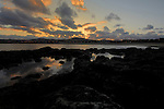 Reflections of clouds in rock pools as the sun sets, Caleta de Fuste, Fuerteventura, Canary Islands, Spain. May 2007