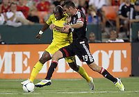 WASHINGTON, DC - AUGUST 4, 2012:  Emilliano Dudar (19) of DC United tackles Emilio Renteria (20) of the Columbus Crew during an MLS match at RFK Stadium in Washington DC on August 4. United won 1-0.