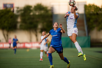 Seattle, WA - Sunday, May 21, 2017: Katlyn Johnson and Alanna Kennedy during a regular season National Women's Soccer League (NWSL) match between the Seattle Reign FC and the Orlando Pride at Memorial Stadium.