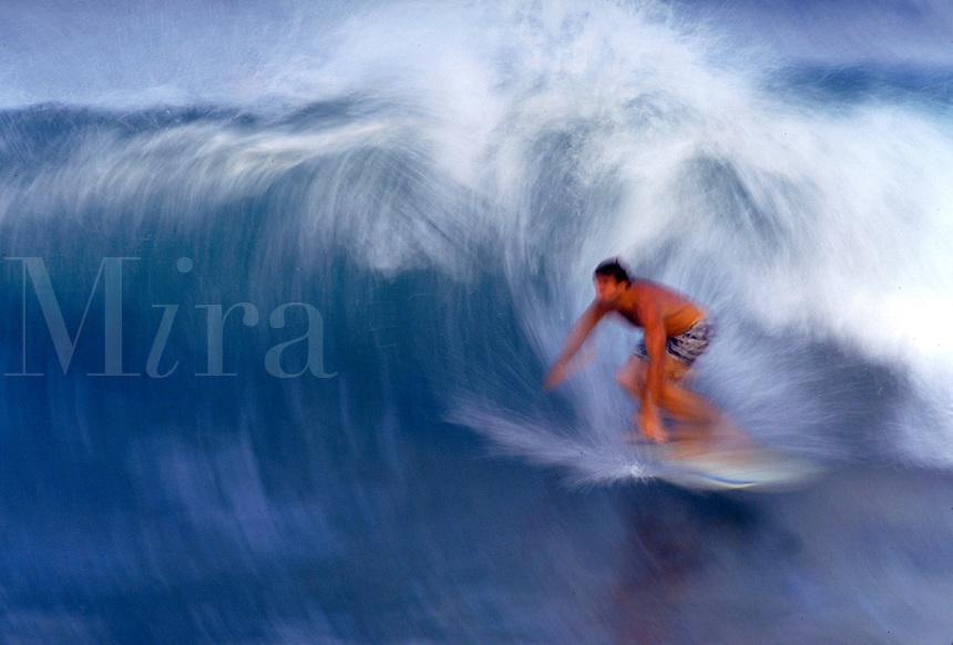 Man surfing at Hapuna Point, Hawaii. Hawaii, Hapuna Point.