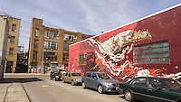 A mural on the side of a building in the Bushwick neighborhood of Brooklyn in New York on Saturday, April 19, 2014. The neighborhood is undergoing gentrification changing from a rough and tumble mix of Hispanic and industrial to a haven for hipsters, forcing many of the long-time residents out because of rising rents.. (©Richard B. Levine)