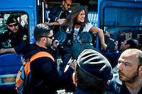 Roma 6 Maggio 2014<br /> Manifestazione dei dipendenti del Comune di Roma, che in migliaia si sono ritrovati in piazza Venezia per partecipare alla protesta contro i tagli ai salari accessori previsti dal Bilancio comunale  appena approvato. Manifestante fermata dalla polizia<br /> Rome May 6, 2014 <br /> Manifestation of the employees of the City of Rome, that to thousands gathered in the Piazza Venezia to participate in the protest against wage cuts fittings for the municipal budget just approved. Protestor stopped by police