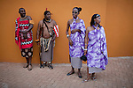 LUDZIDZINI, SWAZILAND - AUGUST 31: Unidentified Swazi people dressed in traditional clothing attend traditional Reed dance ceremony at the Royal Palace on August 31, 2009, in Ludzidzini, Swaziland. About 80.000 virgins from all over the country attended this yearly event, which goes on for a week and which is the biggest in Swazi culture. Many of the girls stayed in tents and slept on the ground. It was founded to celebrate the beauty of Swazi women and girls. King Mswati III, and absolute monarch, was born in 1968 and he has 14 wives and many children. The king danced with his men in front of the 80.000 girls. Many of the girls hope to get noticed by the king and to be chosen as a future wife, a ticket from poverty and into a life of privilege and luxury. The country is one of the poorest in the world and it is struggling with a high prevalence of HIV-Aids and severe poverty. (Photo by: Per-Anders Pettersson)..
