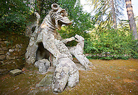Statue of a dragon, representing wisdom,  fighting a dog and wolf, commissioned by Piaer Francesco Orsini c. 1513-84, The Renaissance Mannerist statues of the Park of Monsters or The Sacred Wood of Bamarzo, Italy
