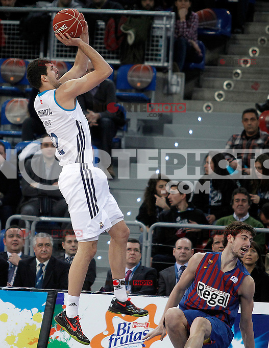 Real Madrid's Nikola Mirotic (l) and FC Barcelona Regal's Ante Tomic during Spanish Basketball King's Cup match.February 07,2013. (ALTERPHOTOS/Acero) /Nortephoto