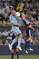 Aurelien Collin (78) defender Sporting KC wins the header against A.J Soares (5) defender New England Revolution..Sporting Kansas City and New England Revolution played to a 0-0 tie at LIVESTRONG Sporting Park, Kansas City, KS.
