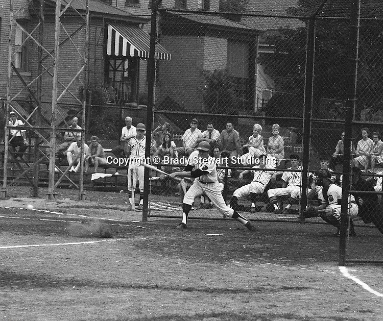 American Legion Baseball:  Bethel Park vs Arnold to advance to the state American Legion Playoffs.  Bob Purkey Jr getting a base hit during the game.  Bob Purkey pitched a shut out (1-0) and the team advance to the state playoffs in Allentown PA - 1970.  Others in the photo; Mr and Mrs Bob Purkey Sr, Mike Stewart, Paul Hauck, Gary Biro, and Bob Colligan.