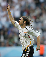 JUNE 9, 2006: Munich, Germany: German midfielder Torsten Frings (8) celebrates his goal during the World Cup Finals in Munich, Germany.  Germany defeated Costa Rica, 4-2.