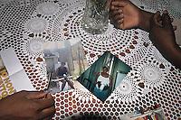 Palermo,  foto di una delle donne che &egrave; stata vittima della tratta,   in una delle foto i segni delle violenze subite dai suoi aguzzini.<br /> Palermo, a former victim of human trafficking shows the photographs portraying a victim forced to prostitution, one of the photos shows the wounds by  captors