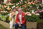 "Maureen Lipman  and Michael Pattemore pose with the new roses named the ""Lynda Bellingham Rose"" At the RHS Hampton Court Flower show, London 29.6.15"