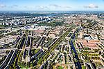 Nederland, Noord-Holland, Amsterdam, 27-09-2015; Amsterdam-Zuid, Rivierenbuurt, onderdeel van Plan-Zuid van H.P. Berlage. In het midden het Twaalfverdiepingenhuis (Wolkenkrabber) van architect  J.F. Staal aan het Victorieplein. Links de Rooseveltlaan nar de RAi, rechts Churchill-laan. Achter de Wolkenkrabber Merwedeplein, aan de horizon de Zuid-as.<br /> Rivierenbuurt, neighbourhood in the south of Amsterdam, part of the Plan Zuid urban expansion programme designed by architect Berlage.  Amsterdam School style architecture. <br /> <br /> luchtfoto (toeslag op standard tarieven);<br /> aerial photo (additional fee required);<br /> copyright foto/photo Siebe Swart