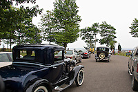 Vintage cars cruise along the waterfront at Presque Isle Park in Marquette Michigan.