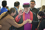 Archbishop Mar Gewargis Sliwa of the Assyrian Church of the East enters a Catholic Church for Mass in a displaced persons camp in Ankawa, near Erbil, Iraq, on April 11, 2016. The Mass concluded a three day visit by Cardinal Timothy Dolan, archbishop of New York and chair of the Catholic Near East Welfare Association, to Iraqi Kurdistan with other church leaders to visit with Christians and others displaced by ISIS.