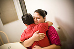 Sophia Sawyer, comforts her son Isaiah January 27, 2010 at their home in Sacramento, Calif. The Sawyer family receives $540/month in CalWORKs assistance from the state of California. Dennis is currently unable to work while recovering from cancer, and Sophia hasn't been able to find work. Gov. Arnold Schwarzenegger has proposed eliminating the CalWORKs program in an effort to balance the state's budget. CREDIT: Max Whittaker for The Wall Street Journal.CABUDGET