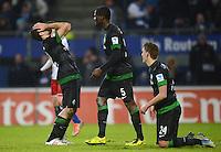 FUSSBALL   1. BUNDESLIGA   SAISON 2012/2013    19. SPIELTAG Hamburger SV - SV Werder Bremen                          27.01.2013 Sokratis Papastathopoulos, Assani Lukimya und Nils Petersen (SV Werder Bremen) sind enttaeuscht