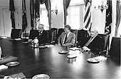 United States President Jimmy Carter meets with officials of the textile union to discuss the multi fiber agreement in the Cabinet Room of the White House in Washington, DC on April 13, 1977.<br /> Credit: White House via CNP