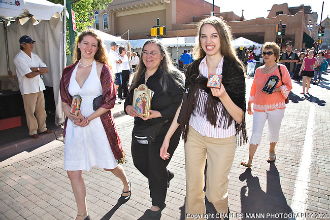 Ellen Chavez de Leitner and her daughters Rose and Genevieve all participate in the Sunday morning Artist's Procession on the plaza at the 2009 Spanish Market in Santa Fe