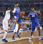 UK guard Andrew Harrison (5) fights for the ball during the NCAA Championship vs. UConn at the AT&T Stadium in Arlington, Tx., on Monday, April 7, 2014. Photo by Emily Wuetcher | Staff