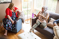SEATTLE, WA-APRIL 17, 2017: Amanda Saab, along with her husband Hussein Saab, host a &quot;dinner with your Muslim neighbor&quot; at the home of Stefanie and Nason (cq) Fox in Seattle, WA on a return trip April 17th 2017. The couple now live in Detroit. The guests are <br /> Anjana Agarwal (black top), Patricia Rangel (black top with pattern), and Greg and Charissa (white top) Pomrehn.<br /> <br /> (Photo by Meryl Schenker/For The Washington Post)